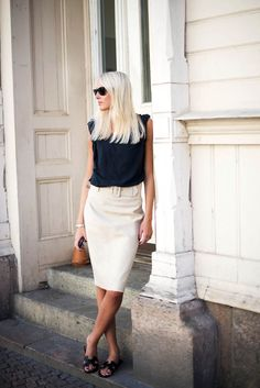 Classic, casual-dress look - black blouse, off-white knee-length skirt, black strappy flats.