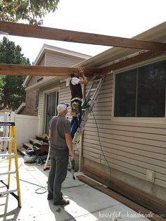 Build a patio pergola attached to the house to extend your living space to the yard. A DIY pergola creates a room outside for entertaining and gathering. Pergola Cost, Small Pergola, Pergola Attached To House, Metal Pergola, Deck With Pergola, Cheap Pergola, Wooden Pergola, Outdoor Pergola, Backyard Pergola