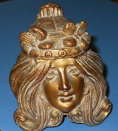An Art Nouveau Ladies Face Inkwell. She has a hinged flower garland that lifts up. American c. 1910__Judith Walker's Collection