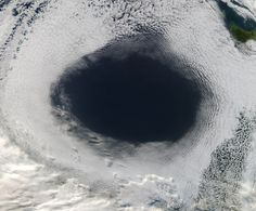 Credit: NASA. A high pressure system created this enormous cloud hole photographed off Australia on June 5, 2012.