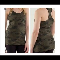 Camo LuluLemon Tank top Size 8, slightly worn, but in really good condition. No tag because they are itchy, so I had cut it off. Reflective logo on the back. lululemon athletica Tops Tank Tops