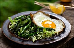 Pan-seared asparagus salad with frisée and fried egg. Photo: Andrew Scrivani for The New York Times