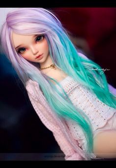 Doll with shades of pastel color hair