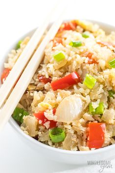 Easy Paleo Cauliflower Fried Rice Recipe - Low Carb - This low carb paleo cauliflower fried rice recipe shows you how to make cauliflower rice stir fry FAST. It's the easiest, best way to cook cauliflower rice.