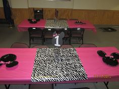I love this idea for decorating the table - hot pink tablecloth (plastic/paper/cloth?) and zebra wrapping paper for the center....I'm thinking you can also use the paper, cut in strips and use as a table runner?? Either way it's super cute!