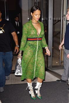 Rihanna shows us again why she's a fashion icon as she steps out in a Gucci V-Neck Lace Dress with Finlay Leather Boots, a Dior Diorever tote and a Jennifer Fischer necklace.