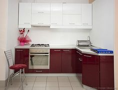 #Kitchen Idea of the Day: A small contemporary kitchen with duo-tone cabinets (maroon base cabinets, white upper cabinets). A lovely effect for a small space.
