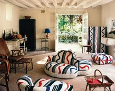 """""""This room in a home in Blois has furnishings upholstered in a textile designed by Sonia Delaunay"""""""