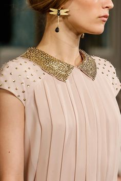 Dragonfly earrings and blush blouse with embellished collar and shoulders