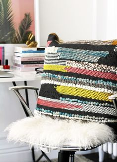 Le Fashion Blog Stylish Whimsical Work Space Urban Outfitters Colorful Colorblock Woven Textured Pillow White Desk Chair Mongolian Fur Throw