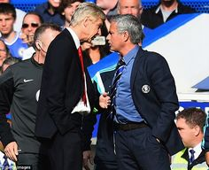 Wenger squares up to the Chelsea manager on the touchline during Sunday's crunch clash at the Bridge