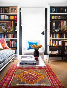 The bold rug and patterned pillows are the perfect pair. | http://domino.com