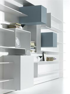 Sectional MDF storage wall VITA by MDF Italia | design Massimo Mariani, Aedas R&S books white