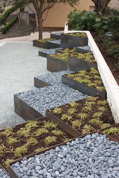Corten planters - I love the multilevel concept. I'd like to modify the look with circular stone planters and maybe some square wood ones.