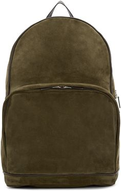 Unstructured suede backpack in 'military' green. Grained leather trim in brown throughout. Carry handle at top. Detachable panel at back face featuring adjustable stowaway shoulder straps. Zippered compartment at face. Leather logo patch at side. Two-way zip closure at main compartment. Zippered pocket at interior. Textile lining in navy. Silver-tone hardware. Tonal stitching. Approx. 14