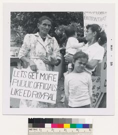 Title:  Abrana Arechiga holds sign expressing support for Ed Roybal  Date:  May 1959  Contributing Institution:  UCLA, Special Collections, Young (Charles E.) Research Library