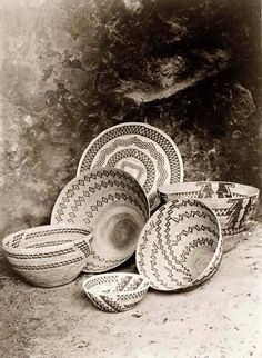 You are looking at an educational picture of Painted Indian Baskets. It was taken in 1924 by Edward S. Curtis.    The picture presents an important craft of the Indians of North America.    We have created this collection of pictures primarily to serve as an easy to access educational tool. Contact curator@old-picture.com.    Image ID# 99E6D2BF