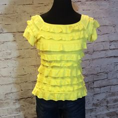 FRANK LYMAN BRIGHT YELLOW RUFFLED TOP This Frank Lyman top will add pizzazz to any skirt or pant. Wear it off the shoulder to add that something special. Super cute and versatile. 65% polyester 35% rayon Frank Lyman Tops Blouses