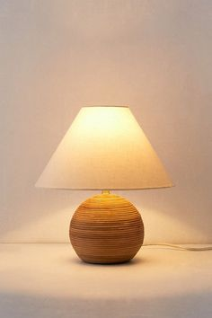Shop Angelo Rattan Table Lamp at Urban Outfitters today. Cool Table Lamps, Side Table Styling, Rattan Lamp, Woven Shades, Arc Floor Lamps, Wicker Furniture, Lamp Design, Desk Lamp, Cleaning Wipes