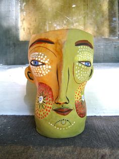 Jenny Mendes makes face cups that resonate deep in my soul.  One side of a probably two sided being, is it doppelganger or twin?