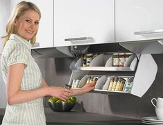 Drop down cupboard drawers like this are great if your short on storage space
