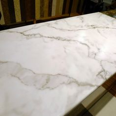 Formica Brand - Calcutta Marble pattern - About $16/sq ft installed at Home Depot!