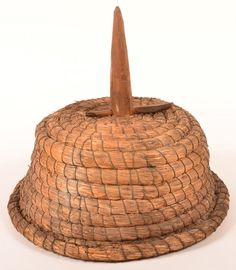 """Rye Straw Coil Bee Skep with Branch Handle. : Lot 133 Rye Straw Coil Bee Skep with Carved Branch Handle. 16-1/2"""" h. overall. 16"""" diam. Condition: Very good, age wear. Harry Hartman Sold $750"""