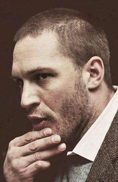 Tom Hardy and his permanently bent little finger