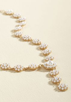 You've been patient in searching for the perfect adornment to elevate your cherished wardrobe offerings, which is why we'd like to reward you with this golden necklace! Dazzling from clasp to pendant with circles of faux pearls, this Y-shaped accessory ends the wait for single-step sophistication. $24