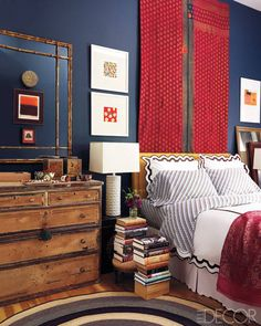 """""""In the master bedroom, a vintage Indian tapestry from Vajra Tibet hangs above a bed dressed in linens by Signoria and Matouk; the coverlet is an antique wedding sari."""" [Janet Brown Interiors sells kanthas, which are throws made from recycled saris.] Design by Elaine Griffin. Photo: Joshua McHugh. """"A Harlem Brownstone's Vivid Transformation"""" by Nancy Hass. Elle Decor."""