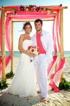#pink groom #pink beach wedding #hot pink wedding arch