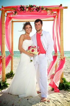 #pink groom #pink beach wedding #hot pink wedding arch