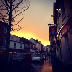 The day has brought hailstone storms and brilliant winter sun. It closes down with a yellow halo skimming the English pub, chimneys and rooves which glisten still from the rain. #sunset #sky #yellow #landscape #skyline #beautiful #architecture #buildings #houses #tree #dusk #silhouette #street #flagstones #sidewalk #english #village #pub #street #symmetry #houses #bucolic #pastoral #romantic #quaint #traditional #saturday