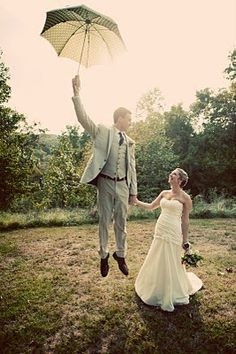 Jump while holding an umbrella photo... genius.