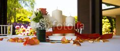 Wedding decorations. Candle, bow and orange flowers