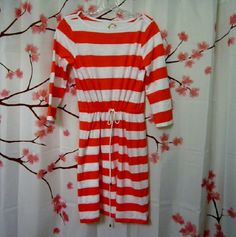 Orange and White Striped Boatneck Dress S Cute and comfortable casual cotton dress, great for a cruise or swim cover up. Rope cinch waist. Worn and washed once. In excellent condition. Comes from a smoke- free, pet-free home. C Wonder Dresses