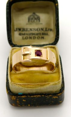 An English Victorian 15k Gold Buckle ring with small ruby 1881