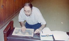 Egyptologist Dr. Wael Sherbiny working on the manuscript at the Cairo Museum