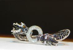 Dragon bracelet with multi-color diamonds by Freytag Farrar Jewelers