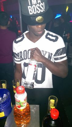 Bottle after bottle, I am balling like Robert Griffin Never made love I had to come  from a distance