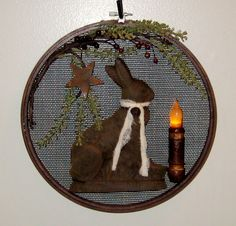 Prim Blackened Beeswax Rabbit...in old wooden grain sieve...with rusty star & grubby lighted candle.