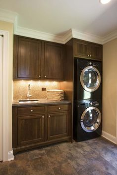 A stacked washer and dryer can save space, as seen in this simple laundry room.