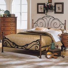 Bring the ambiance of a bed and breakfast setting to your home with the Verona Home Sheridan Queen Poster Bed. Inspired by Victorian design, ornate scrolls and elegant finials grace this metal frame. Features a bronze finish. King Size Headboard, Headboard And Footboard, Recamaras King Size, Queen Size, Four Poster Bed Frame, Brass Bed, Beds For Sale, Metal Beds, Adjustable Beds