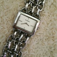 Fossil Ladies Watch Stainless steel triple chain band. Rectangular face with second hand. Working condition with battety. Water resistant to 30 meters. Fossil Accessories Watches