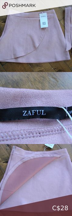 """Zaful Blush Pink Faux Suede A-Line Mini Skirt NWT Zaful Pink Faux Suede A-Line Mini Skirt ~ NWT ~ Size S ~ 95% Polyester, 5% Spandex ~ waist measures 13"""" across and stretches This skirt is super soft and super comfy. It features a beautiful pink blush colour, side zipper, front flap with a nice stretch to it. Also comes with a tie belt if you wanted to use. Pair it with tights and booties and you'll look great!!! Excellent brand new with tags condition ~ no rips, tears, holes or stains Zaful…"""