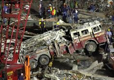 Work crews lift a fire truck from the debris of the collapsed World Trade Center in this Sept. 2001 file photo, in New York. We Will Never Forget, Lest We Forget, World Trade Center, Trade Centre, Flatiron Building, Illuminati, 11 September 2001, Moslem, Historia Universal