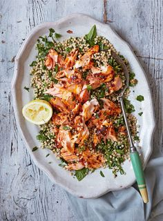 Roast Harissa Salmon With Lemony Giant Couscous from Great British Bake Off: Winter Kitchen. This dish is full of flavour from the warming, chilli harissa and the lemon dressing, which coats the giant couscous. A great healthy and delicious dinner. Salmon Recipes, Fish Recipes, Seafood Recipes, Dinner Recipes, Cooking Recipes, Healthy Recipes, Broccoli Recipes, Recipies, Salmon Dishes