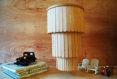 Turn embroidery hoops and popsicle sticks into a beautiful chandelier