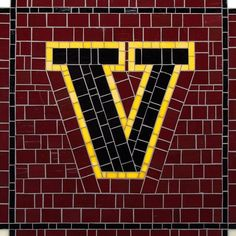 Mosaic Letter V - The Tieton Alphabet  Tieton Mosaic is a mosaic sign company in Tieton, WA specializing in typographic glass mosaic signage
