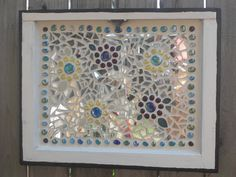 Old window transformed into a garden mosaic.
